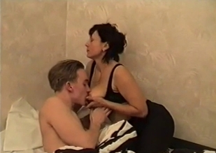 Busty mommy in black seducing her son