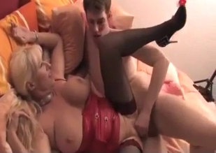 Fat blonde in red sucking son's sexy cock