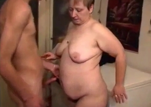 Short-haired MILF tastes her son's cock