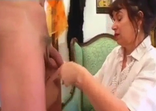 White blouse MILF stroking son's big cock