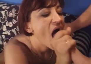 Short-haired MILF fucking her hung son